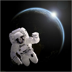 Adesivo murale  Astronaut floating in space as the sun rises on to Earth-like planet. - Marc Ward