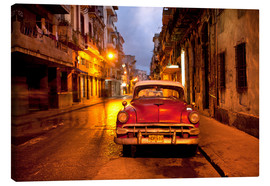 Stampa su tela  Red vintage American car in Havana - Lee Frost