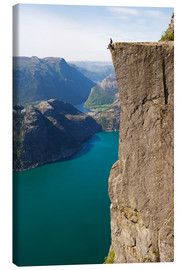 Stampa su tela  Man sitting on Pulpit Rock, Lysefjord - Christian Kober