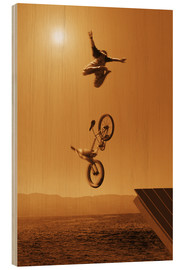Stampa su legno  Cyclist Going Off Jump Into Water In Brown Tones - Don Hammond