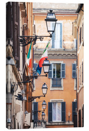Stampa su tela  Street in the centre of old town with italian flags, Rome, Italy - Matteo Colombo