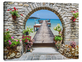 Stampa su tela  Ocean view through a stone arch