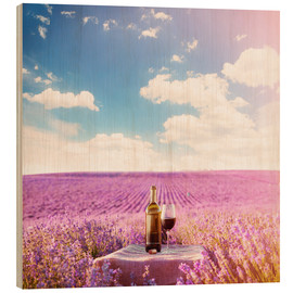 Red wine bottle and wine glass in lavender field