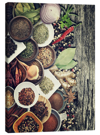Stampa su tela  Spices And Herbs On Rusty Old Wood
