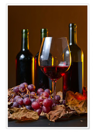 Poster Premium  red wine with grapes and vine leaves
