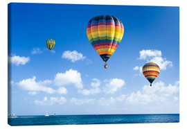 Stampa su tela  Colorful hot air balloons on the blue sea