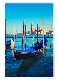 Gondolas in lagoon of Venice on sunrise
