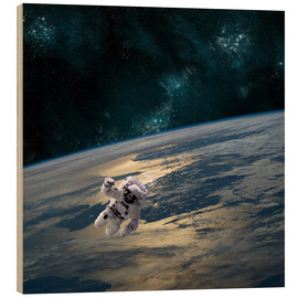Stampa su legno  An astronaut floating above Earth. - Marc Ward
