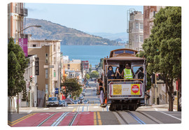 Stampa su tela  Cable car on a hill in the streets of San Francisco, California, USA - Matteo Colombo
