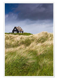 Poster Premium  Cottage in the dunes during storm