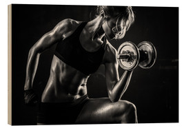 Legno  Sportswoman with dumbbells