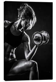 Stampa su tela  Sportswoman with dumbbell