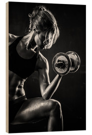 Legno  Sportswoman with dumbbell