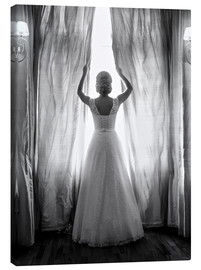 Stampa su tela  Elegant bride at big window