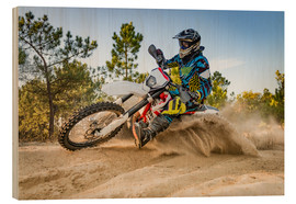 Legno  Enduro biker on sand terrain