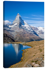 Stampa su tela  Hikers walking on the path beside the Stellisee with the Matterhorn reflected. Zermatt Canton of Val - Roberto Sysa Moiola