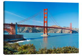 Stampa su tela  The Golden Gate Bridge in San Francisco with beautiful blue ocean in background