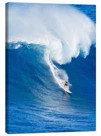 Stampa su tela  Extreme surfer riding giant ocean wave in Hawaii