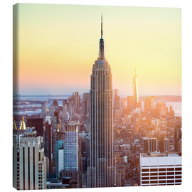 Stampa su tela  Empire State Building in New York City at sunset - Jan Christopher Becke