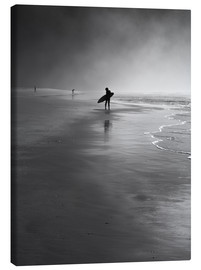 Tela  A lone surfer on his way into the sea. - Alex Saberi