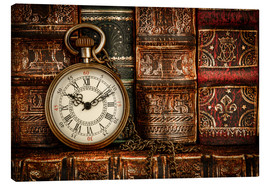 Tela  Clock in front of books