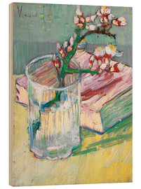 Stampa su legno  Flowering almond branch in a glass with a book - Vincent van Gogh