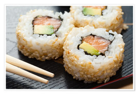 Poster Premium  Sushi on wooden plate with chopsticks