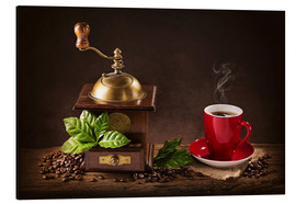 Stampa su alluminio  Coffee mill with beans and green leaves and a cup of coffee - Elena Schweitzer