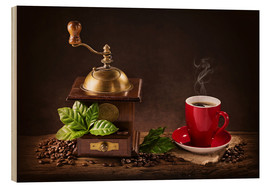 Stampa su legno  Coffee mill with beans and green leaves and a cup of coffee - Elena Schweitzer