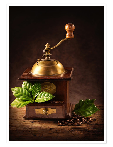 Poster Premium Coffee mill with beans and green leaves and a cup of coffee