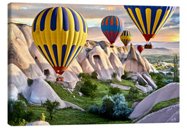 Stampa su tela  Hot air balloons over Goreme tuff rock formations