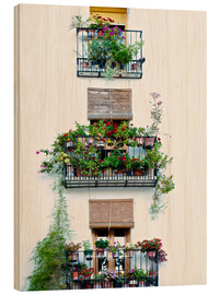 Stampa su legno  Facade with balconies full of flowers in Valencia