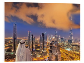 Arab man looks over Dubai