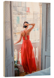 Stampa su legno  Young attractive woman in red dress