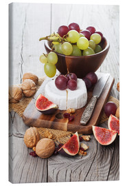 Stampa su tela  Camembert cheese with figs, nuts and grapes