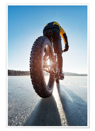 Poster Premium  Man cycling on a frozen lake - Johner