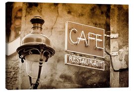 Stampa su tela  Cafe sign and lamp post, Paris, France. - age fotostock