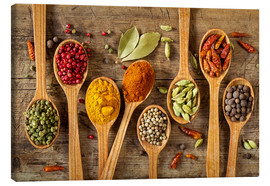 Stampa su tela  Colorful spices in wooden spoons - Elena Schweitzer